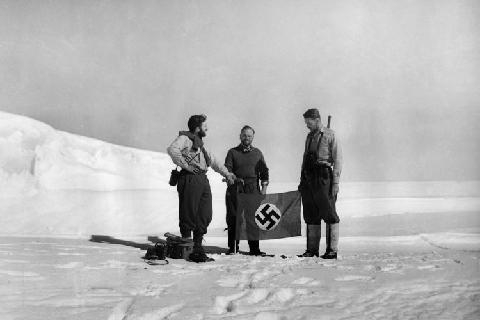Nazi Antarctica: Group of Men holding a flag