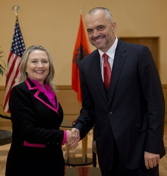 Hillary Clinton (left) and Albanian Xhakja Clan mafia crime leader Edi Rama (right)